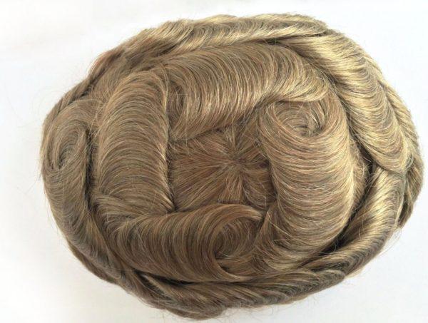 Pieza de pelo protesis capilar pelo humano para hombres mujeres. Bonny es una pieza con un monofilamento central de 10x12 cm, con un poly reforzado de casi 4cm